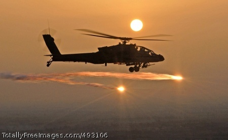 Soldier Silhouettes An AH-64D Apache helicopter fires flares as Soldiers from the 227th Aviation Regiment, 1st Air Cavalry Brigade, 1st Cavalry Division, based at Camp Taji, conduct a mission over Iraq, April 29. Photo Credit: Jun 7, 2007