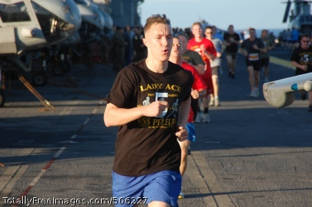 101213-N-7438S-006 PACIFIC OCEAN (Dec. 13, 2010) Sailors and Marines participate in the Lady Ace 5K run on the flight deck of the amphibious assault ship USS Peleliu (LHA 5). The race was sponsored by Helicopter Marine Medium Squadron (HMM) 165 (Reinforced) and raised more than $3,600 for the Semper Fi Fund to help support injured Marines. Peleliu is the flagship for the Peleliu Amphibious Ready Group, which is transiting the Pacific Ocean to homeport at San Diego following a seven-month deployment. (U.S. Navy photo by Senior Chief Mass Communication Specialist Dan Smithyman/Released)