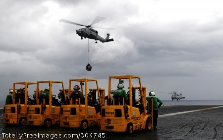 110129-N-8040H-212 BAY OF BENGAL (Jan. 29, 2011) Sailors aboard the aircraft carrier USS Carl Vinson (CVN 70) await supplies as an SH-60B Sea Hawk helicopter transports cargo onto the ship's flight deck during replenishment at sea with the Military Sealift Command fleet replenishment oiler USNS Henry J. Kaiser (T-AO 187). Carl Vinson and Carrier Air Wing (CVW) 17 are deployed to the U.S. 7th Fleet area of responsibility. (U.S. Navy photo by Mass Communication Specialist 3rd Class Christopher K. Hwang/Released)