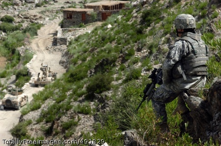 Overwatch Security 1st Lt. William Cromie , Company A, Special Troops Battalion, 173rd Airborne Brigade Combat Team, watches his Soldiers as they clear an ambush point previously used by Taliban extremists in Chowkay Valley, Afghanistan, Aug. 15. Photo Credit: Aug 29, 2007