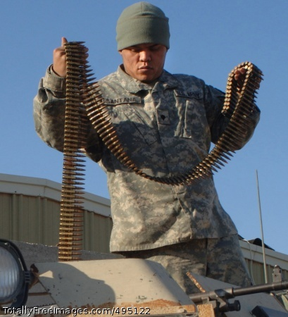 Don't Leave Home Spc. Jesus Santana, from the 2nd Infantry Division, ensures there is sufficient ammunition for his weapon prior to a patrol in Baghdad, Jan. 23. Photo Credit: Feb 5, 2007