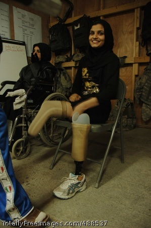 Caring for the An Iraqi woman with prosthetic legs prepares to go to a physical therapy session on Patrol Base Assassin, Iraq, Jan. 10, where Soldiers from the 3rd Infantry Division are stationed. The woman lost both legs three years ago during an enemy rocket attack in Rustamiyah.  Photo Credit: Jan 18, 2008