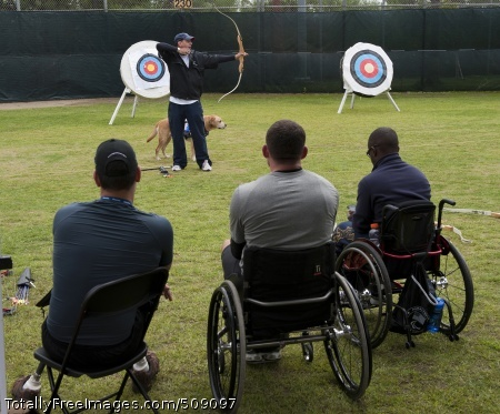 101005-N-7981E-610 SAN DIEGO (Oct. 5, 2010) Retired Army Cpl. Kevin Stone, a 2004 and 2008 Team U.S.A. Paralympic gold medalist and a current world record holder, teaches archery techniques to service members during the U.S. Olympic Committee Paralympic Military Sports Camp at Naval Medical Center San Diego. More than 60 injured service members from U.S., British, and Israeli armed forces participated in the four-day event designed to introduce paralympic sport to active duty military personnel and veterans with physical injuries. (U.S. Navy photo by Mass Communication Specialist 2nd Class James R. Evans/Released)