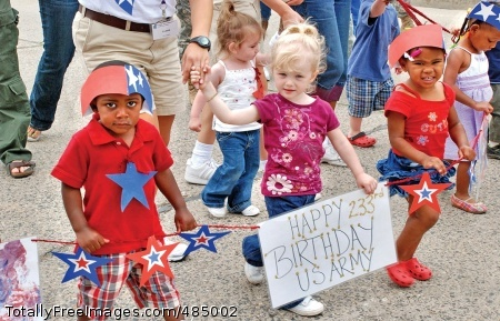 Wiesbaden Youth from the U.S. Army Garrison Wiesbaden Child Development Center celebrate the Army's 233rd birthday during a parade on Wiesbaden Army Airfield, Germany.  Photo Credit: Jun 13, 2008