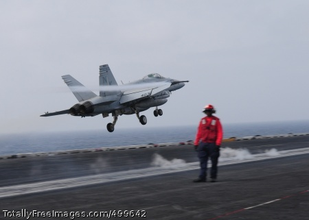 110604-N-SG869-077 ARABIAN SEA (June 4, 2011) An F/A-18C Hornet assigned to the Death Rattlers of Marine Fighter Attack Squadron (VMFA) 323 conducts touch and go landings aboard the aircraft carrier USS Ronald Reagan (CVN 76). Ronald Reagan and Carrier Air Wing (CVW) 14 are deployed to the U.S. 5th Fleet area of responsibility, conducting close-air support missions as part of Operation Enduring Freedom.  (U.S. Navy photo by Mass Communication Specialist 2nd Class Josh Cassatt/Released)