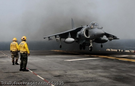 110411-N-7508R-002 ATLANTIC OCEAN (April 11, 2011) Landing signal enlisted (LSE) personnel observe as  AV-8B Harrier assigned to Marine Medium Tiltrotor Squadron (VMM) 263 (Reinforced) land aboard the multipurpose amphibious assault ship USS Bataan (LHD 5). Bataan is deploying to the Mediterranean Sea. (U.S. Navy photo by Mass Communication Specialist 2nd Class Julio Rivera/Released)