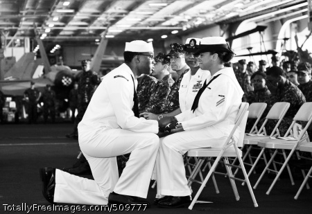 100915-N-6003P-091 ARABIAN SEA (Sept. 15, 2010) Aviation Structural Mechanic Airman Ismayda Acquie receives a flag and condolences from Chief Machinist's Mate (Sel.) John J. Matthews during the 9/11 Memorial Remembrance Ceremony aboard the aircraft carrier USS Harry S. Truman (CVN 75). Acquie lost her father, police officer Jay Ruiz, in the attacks on the World Trade Center Sept. 11, 2001. Harry S. Truman is deployed as part of the Harry S. Truman Carrier Strike Group supporting maritime security operations and theater security cooperation efforts in the U.S. 5th Fleet area of responsibility. (U.S. Navy photo by Mass Communication Specialist 2nd Class Kilho Park/Released)