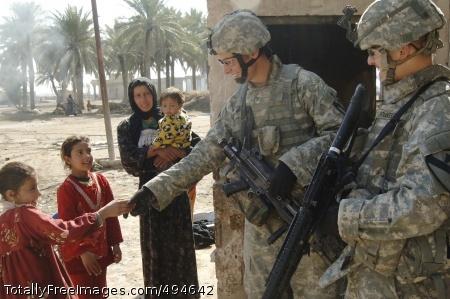 A Day With 5th Pfc. Kurtis Tripp, a rifleman/squad automatic gunner, greets an Iraqi family. Photo Credit: Mar 5, 2007