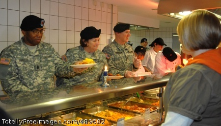 Thanksgiving in MANNHEIM, Germany - From left: 5th Signal Command's Command Sgt. Maj. Roderick D. Johnson; commander, Brig. Gen. Susan S. Lawrence; and Capt. Benjamin Anderson, of U.S. Army Garrison Mannheim, serve Thanksgiving lunch to more than 300 hungry servicemembers and civilians at 5th Signal's 44th Expeditionary Signal Battalion dining facility here.  Photo Credit: Nov 26, 2007