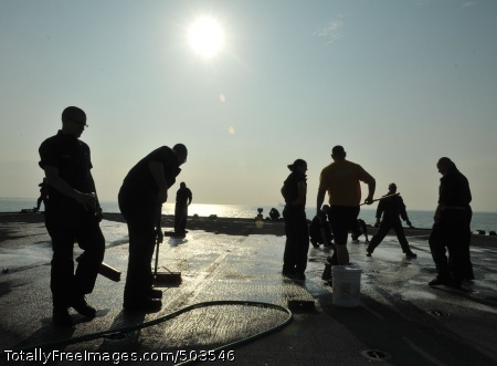 110306-N-0864H-301 PACIFIC OCEAN (March 6, 2011) Aircrew members assigned to the Warlords of Light Helicopter Anti-Submarine Squadron (HSL 51) scrub the flight deck for debris aboard the U.S. 7th Fleet command ship USS Blue Ridge (LCC 19). Blue Ridge serves under Commander, Expeditionary Strike Group (ESG) 7/Task Force (CTF) 76, the Navy's only forward deployed amphibious force. (U.S. Navy photo by Mass Communication Specialist 3rd Class Fidel C. Hart/Released)
