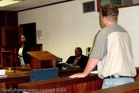 "South Africa Fighting White Collar Crime South African Prosecutor Glynnis Breytenbach, far left,  shown here during a court appearance, received training backed by USAID to better fight white-collar crime in the country's courts. In 1999, a Specialized Commercial Crime Court and Prosecuting Unit was established in Pretoria. ""The Unit,"" as it is called, had almost no budget when it opened its doors. Working with an association of South African corporations, USAID stepped in, providing training in trial skills for financial crimes.  A computerized case load management system was established to enhance their work. The Unit works as a team with police, investigators, and dedicated magistrates. South Africa Date: 2006 Photographer: Unknown / USAID"