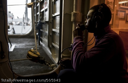 101221-N-7981E-606 PACIFIC OCEAN (Dec. 21, 2010) Aviation Boatswain's Mate (Fuel) Airman Spenser Hood communicates with a fuel pump room via a sound-powered phone from a refueling station aboard the aircraft carrier USS Carl Vinson (CVN 70). Carl Vinson is taking aboard JP-5 fuel from the Military Sealift Command fleet replenishment oiler USNS Guadalupe (T-AO 200). Carl Vinson and Carrier Air Wing (CVW) 17 are on a deployment to the U.S. 7th and U.S. 5th Fleet areas of responsibility. (U.S. Navy photo by Mass Communication Specialist 2nd Class James R. Evans/Released)