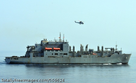 100918-N-7948R-174  ARABIAN SEA (Sept. 18, 2010) An SA-330J Puma helicopter flies over the Military Sealift Command dry cargo and ammunition ship USNS Lewis and Clark (T-AKE 1) during a replenishment at sea. Lewis and Clark replenished elements of the Peleliu Amphibious Ready Group which are supporting maritime security operations and theater security cooperation efforts in the U.S. 5th Fleet area of responsibility. (U.S. Navy photo by Mass Communication Specialist 2nd Class Michael Russell/Released)