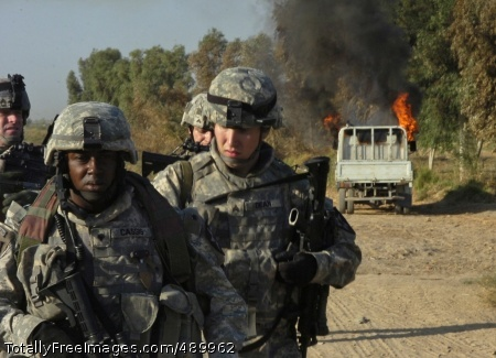 Operation Ultra Spc. Billy Cassis, Sgt. Brandon Dean and other Soldiers from the 4th Stryker Brigade Combat Team, 2nd Infantry Division, Task Force Iron, walk away from an insurgent vehicle they torched near an insurgent safe house south of Hussein Hamadi village, Iraq, during Operation Ultra Magnus.  Photo Credit: Nov 7, 2007