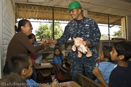 110222-N-UX336-019 LA UNION, El Salvador (Feb. 22, 2011) Hospital Corpsman 2nd Class Robert Medina, a medical subject matter expert embarked aboard High Speed Vessel Swift (HSV 2) hands a stuffed animal donated by Loving Hugs, Inc., to a teacher at Centro Escolar Republica de Honduras during a Southern Partnership Station 2011 community service event. The toys were delivered as part of Project Handclasp, a Navy program that accepts and transports educational, humanitarian and goodwill goods on a space available basis aboard U.S. Navy ships for distribution to foreign nation recipients. Southern Partnership Station is an annual deployment of U.S. ships to the U.S. Southern Command area of responsibility in the Caribbean and Latin America. (U.S. Navy photo by Chief Mass Communication Specialist Aaron Strickland/Released)