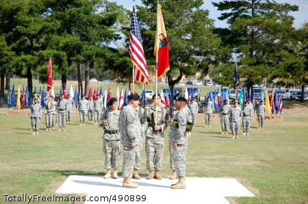 New Active-Duty Col. Gregory Watt, commander of the 1st Combat Support Brigade (Maneuver Enhancement), and Command Sergeant Major Ted Lopez, 1st CSB CSM, uncase the unit's colors during its Oct. 2 activation ceremony.     Photo Credit: Oct 3, 2007