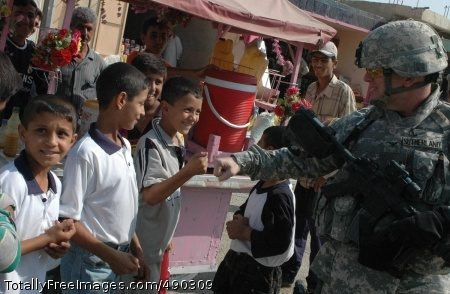Col. David Sutherland, commander of Coalition Forces in Diyala province, Iraq, greets local children while patrolling the Old Baqouba market in the province's capital city, Oct. 21. Prior to Operations Arrowhead Ripper and Lighting Hammer, the city was virtually shut down due to widespread fear of extremist organizations.  Photo Credit: Oct 26, 2007