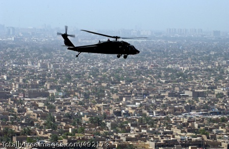 Bird's-Eye View A UH-60 Black Hawk helicopter crew conducts a mission over Baghdad.  Photo Credit: Aug 7, 2007