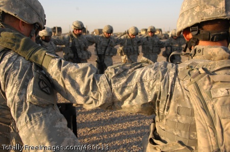 Armor for the Soul Soldiers from Battery A, 2nd Battalion, 32nd Field Artillery Regiment say a prayer at Forward Operating Base Liberty, Iraq, before a mission. Photo Credit: Dec 19, 2007