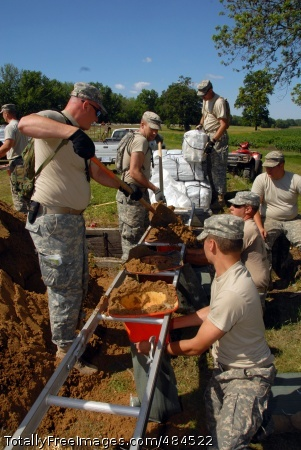 Iowa Guard Fills Soldiers assigned to 1-168th Infantry, Iowa Army National Guard, fill sandbags June 17, for crews working to reinforce a levee protecting homes and of crops from rising Mississippi River floodwaters.  Photo Credit: Jun 20, 2008