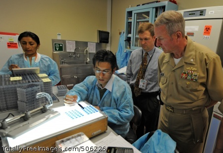 101213-N-7589W-043 LIMA, Peru (Dec. 13, 2010) A Peruvian lab technician, center, explains antibody testing procedures to Capt. John Sanders, commanding officer of Naval Medical Research Unit (NMRU) 6, and Cmdr. Mark Becker, mission commander of Southern Partnership Station 2011, during a tour of the NMRU compound. Southern Partnership Station is an annual deployment of U.S. ships to the U.S. Southern Command area of responsibility in the Caribbean and Latin America to share information with navy, coast guard and civilian services throughout the region. (U.S. Navy photo by Mass Communication Specialist 1st Class Jeffery Tilghman Williams/Released)
