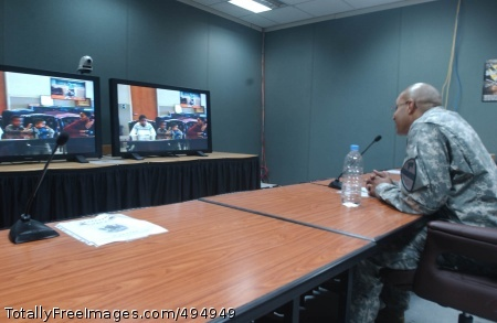 Technology Helps Staff Sgt. Lorenzo Antley, a military intelligence analyst with the Division Special Troops Battalion, 1st Cavalry Division, speaks with his family at Fort Hood, Texas, on Feb. 4 via video teleconference in the division headquarters' 'Stetson Room.'     Photo Credit: Feb 12, 2007