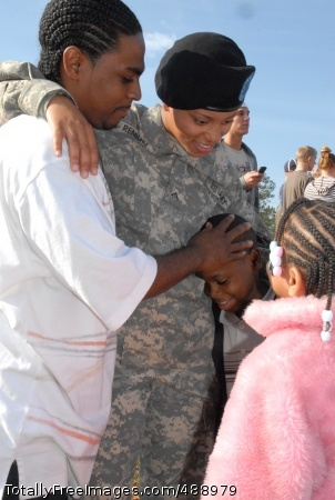 Series 5 - FD Pvt. Monique Remigio, Company C, 2nd Battalion, 13th Infantry Regiment, greets her husband Eduardo, Darnell, 7, and Kyla, 6, during Family Day at the MG Robert B. Solomon Center Dec. 13. Photo Credit: Dec 20, 2007