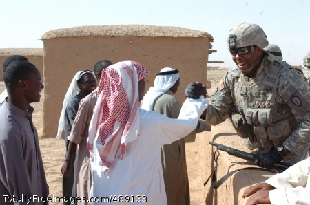 Warm Welcome Sgt. Elliot Edmunds, a cavalry scout with 4th Cavalry Regiment, greets Iraqi villagers during an operation south of Tal Afar. Photo Credit: Dec 14, 2007