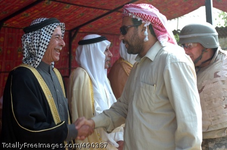 Sunni and Shia tribal sheiks greet each other at the opening of the Sheiks Conference Center near Taji, Iraq Oct. 18.  The center is neutral ground for sheiks of all tribes to gather and reconcile.  The center was christened with a meeting and ended with everyone feasting together.  Photo Credit: Oct 24, 2007