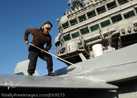 100921-N-2821G-036  PACIFIC OCEAN (Sept. 21, 2010) Aviation Electronics Technician Airman David Bohorquez, from Charlotte N.C., washes an F/A-18C Hornet assigned to the Blue Blasters of Strike Fighter Squadron (VFA) 34 aboard the Nimitz-class aircraft carrier USS Abraham Lincoln (CVN 72). VFA-34 is part of the Abraham Lincoln Carrier Strike Group, which is on a scheduled deployment to the U.S. 7th and 5th Fleet areas of responsibility. (U.S. Navy photo by Mass Communication Specialist 2nd Class Alan Gragg/Released)