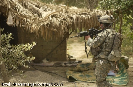 Combined Forces A Soldier from 1st Battalion, 12th Cavalry Regiment, 3rd Brigade Combat Team, 1st Cavalry Division clears the suspected prison camp where 41 people were liberated. Photo Credit: May 30, 2007