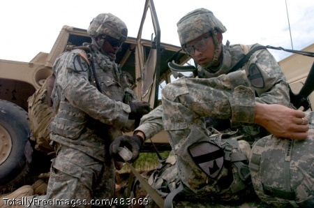 Pfc Antonio Champion (left), of Denmark, S.C., and Spc. Jose Saenz, of Houston, Texas, secure their patient onto a spine board during the 4th Squadron, 9th Cavalry Regiment, 2nd Brigade Combat Team, 1st Cavalry's Air MEDEVAC at the EMFB site July 24.   Photo Credit: Jul 28, 2008