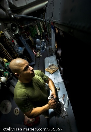 110119-N-2055M-059  SOUTH CHINA SEA (Jan. 19, 2011) Aviation Ordnanceman 2nd Class Adrel Alcaraz-Medina performs maintenance on a sono launcher on an SH-60B Sea Hawk helicopter assigned to Helicopter Anti-Submarine Squadron (HSL) 49 aboard the Arleigh Burke-class guided-missile destroyer USS Gridley (DDG 101). Gridley is on deployment with the Carl Vinson Carrier Strike Group to the U.S. 7th Fleet area of responsibility. (U.S. Navy photo by Mass Communication Specialist 3rd Class Travis K. Mendoza/Released)