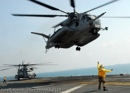 110210-N-8607R-210 GULF OF THAILAND (Feb. 10, 2011) Aviation Boatswain's Mate (Handling) 3rd Class Mario Teasley directs a CH-53E Sea Stallion helicopter to take off from the forward-deployed amphibious assault ship USS Essex (LHD 2). The 31st Marine Expeditionary Unit and the Essex Amphibious Ready Group are participating in Exercise Cobra Gold 2011, a U.S. and Thailand co-sponsored multi-national exercise designed to improve interoperability between participating nations. (U.S. Navy photo by Mass Communication Specialist 2nd Class Eva-Marie Ramsaran/Released)