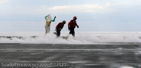 110131-N-3374C-063 ATLANTIC OCEAN (Jan. 31, 2011) Sailors run across the flight deck of the aircraft carrier USS George H.W. Bush (CVN 77) during flight operations. George H.W. Bush is in the Atlantic Ocean conducting a composite training unit exercise. (U.S. Navy photo by Mass Communication Specialist 3rd Class Tony Curtis/Released)