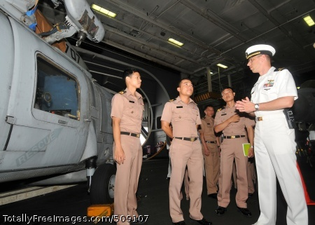 101004-N-9643S-018  PACIFIC OCEAN (Oct. 4, 2010) Ensign Shawn Horigan gives a tour of the hangar bay to members of the Royal Thai Navy aboard the aircraft carrier USS George Washington (CVN 73). George Washington is making a port visit in Thailand as an opportunity to strengthen ties with the partner nation. (U.S. Navy photo by Mass Communication Specialist 3rd Class Stephanie Smith/Released)