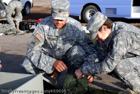Olathe, Colo., native Staff Sgt. Raymond Martinez and Springfield, Ill., native Staff Sgt. Christine Cooper, both operations noncommissioned officers with Headquarters Support Company, Special Troops Battalion, 1st Cavalry Division, inventory their Combat-Life-Saver bags before loading them into a shipping container at their battalion's motor pool on Camp Liberty in western Baghdad, Nov. 15. Throughout the remainder of November, Soldiers with the STB will be loading their gear in preparation of their redeployment back to Fort Hood, Texas next month. Photo Credit: Nov 19, 2007