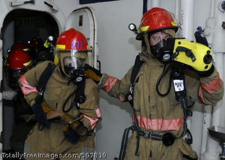 101104-N-3154P-007 GULF OF ADEN (Nov. 4, 2010) Damage Control Fireman David Struwe, the fire party leader, uses a naval firefighting thermal imager to guide the lead nozzleman, Hull Technician 3rd Class Edward Dekok, into a space during an at sea fire party exercise aboard the amphibious assault ship USS Kearsarge (LHD 3). Kearsarge is the command ship of the Kearsarge Amphibious Ready Group, supporting maritime security operations and theater security cooperation efforts in the U.S. 5th Fleet area of responsibility. (U.S. Navy photo by Mass Communication Specialist 3rd Class Scott Pittman/Released)