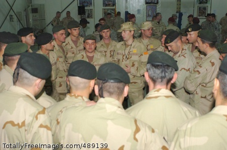 After a transfer of authority ceremony, incoming Macedonian troops from the Macedonian Rangers, Macedonian Special Forces Battalion, receive a briefing at Camp Taji, Iraq Dec. 12 from Macedonian Maj. Marjan Jachevski (center), the Macedonian liaison officer for Multi-National Force-Iraq, on the types of things they should expect during their six-month rotation to Iraq. Jachevski also gave the troops some words of encouragement as they begin their tour. Photo Credit: Dec 14, 2007