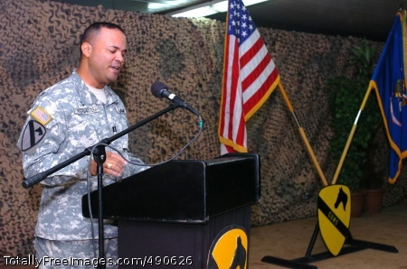 Camuy, Puerto Rico, native Chap. (Capt.) Leonardo Rivera, the chaplain for 615th 'Cold Steel' Aviation Support Battalion, 1st Air Cavalry Brigade, 1st Cavalry Division, speaks during the Hispanic Heritage Month ceremony at Camp Taji, Iraq, Oct. 6. Rivera explained that his love for America and Puerto Rico are one and the same, but he'll never forget his roots.  Photo Credit: Oct 10, 2007