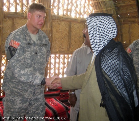 Lt. Col. Scott Kendrick, the commander of the Long Knife Brigade's 2-12 Cav. Regt., greets one of the Muthanna province's leaders during a hail-and-farewell for the 4th BCT, 1st Cav. Div., and the outgoing 1st BCT, 82nd Abn.Div., in the province June 30. Photo Credit: Jul 14, 2008