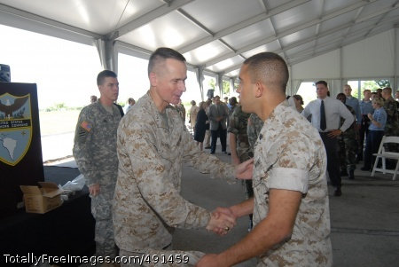 Joint Chiefs .S. Marine Gen. Peter Pace, Chairman of the Joint Chiefs of Staff, greets a Marine sergeant during a farewell visit to the U.S. Southern Command's headquarters here today. During his visit, Pace took time to individually thank more than 1,300 military and civilian personnel from SOUTHCOM for their contributions to U.S. national security and stability in the Western Hemisphere.  Photo Credit: Sep 17, 2007