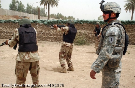 Provincial Staff Sgt. Humberto Moreno supervises the training of Iraqi Soldiers at the Black Falcon training center in Adhamiya, June 12. While the Iraqi Army continues to grow in capabilities and effectiveness, the performance of the national and local police has been a 'mixed bag' over the past two years, said Brig. Gen. Edward Cardon. Photo Credit: Jul 24, 2007