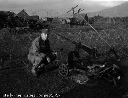 Captured Weapon Bruce poses next to captured Chinese-made anti-aircraft weapon while on duty in Vietnam, 1966. Photo Credit: Feb 7, 2007