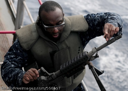 101028-N-5538K-360  SOUTH CHINA SEA (Oct. 28, 2010) Aviation Ordnanceman 1st Class Justin L. McCray replaces the barrel of a M-240B machine gun during a live-fire exercise aboard the forward-deployed amphibious assault ship USS Essex (LHD 2). Essex is part of the forward-deployed Essex Amphibious Ready Group and is underway in the western Pacific Ocean. (U.S. Navy photo by Mass Communication Specialist 3rd Class Casey H. Kyhl/Released)