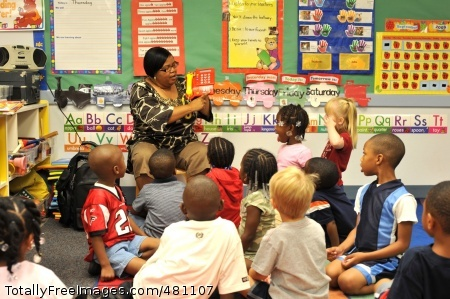 Staff takes Joyce Matthews, lead pre-kindergarten teacher at the Fort McPherson Child Development Center, demonstrates to students how to call  911 for an emergency during the Ready Army presentation held Sept. 19. Photo Credit: Sep 26, 2008