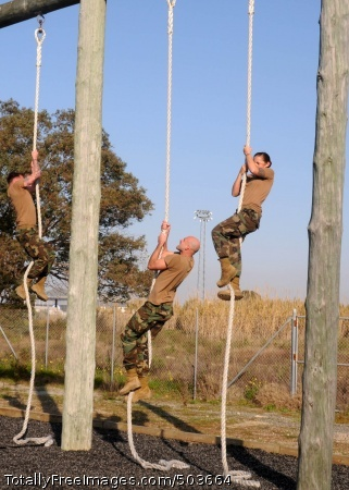 110211-N-AW868-056 ROTA, Spain (Feb. 11, 2011) Seabees assigned to Alfa Company of Naval Mobile Construction (NMCB) 74 attempt the Marine Corps obstacle course at Naval Station Rota, Spain. NMCB-74 is deployed to Camp Mitchell on Naval Station Rota supporting Commander, Task Force (CTF) 68. (U.S. Navy photo by Mass Communication Specialist 1st Class Ryan G. Wilber/Released)