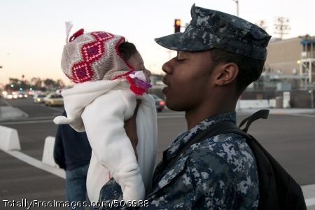 101130-N-9123L-011 CORONADO, Calif. (Nov. 30, 2010) Boatswain's Mate Seaman Issac Doyle says goodbye to his daughter as he prepares to board the aircraft carrier USS Carl Vinson (CVN 70) before the ship departs Naval Air Station North Island for a three-week composite training unit exercise and a deployment to the western Pacific Ocean. (U.S. Navy photo by Mass Communication Specialist 2nd Class Byron C. Linder/Released)