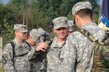 U.S. Army Europe Staff Sgt. Michael Gabel of USAREUR's D Company, 1st Battalion, 503rd Infantry, shares a laugh with Capt. Jonathan Ng during a unit-sponsored trip to Poland in August 2007 designed to build partnerships between Southern European Task Force Soldiers and allied troops from five countries. Gabel, who died in combat in December, bequeathed $20,000 to his unit's rear detachment Photo Credit: Jan 17, 2008