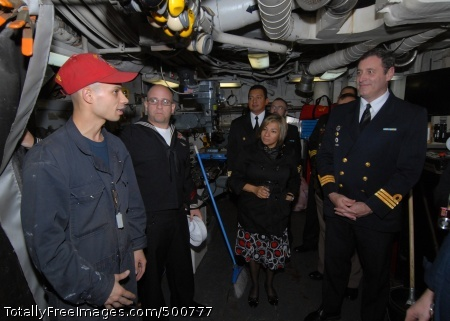 110513-N-ZI300-201 MONTEVIDEO, Uruguay (May 13, 2011) Hull Technician Fireman Edwin Acevado explains the general workshop aboard the guided-missile frigate USS Boone (FFG 28) during a reception hosted by the U.S. Embassy in Uruguay. Boone is deployed to South America supporting Southern Seas 2011. (U.S. Navy photo by Mass Communication Specialist Steve Smith/Released)